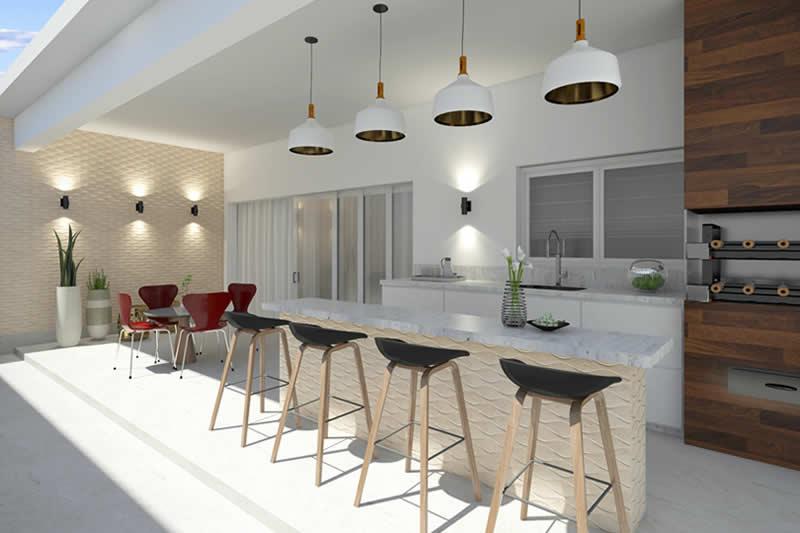 Área gourmet com bancada e mesa