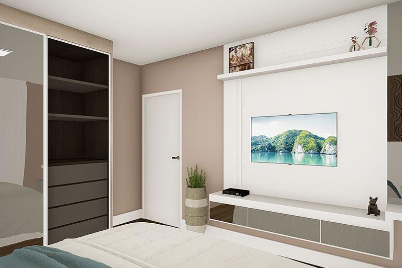 Quarto com tv em frente a cama