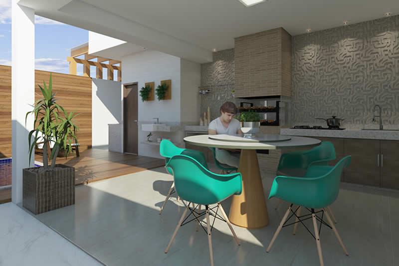Área gourmet com mesa e churrasqueira