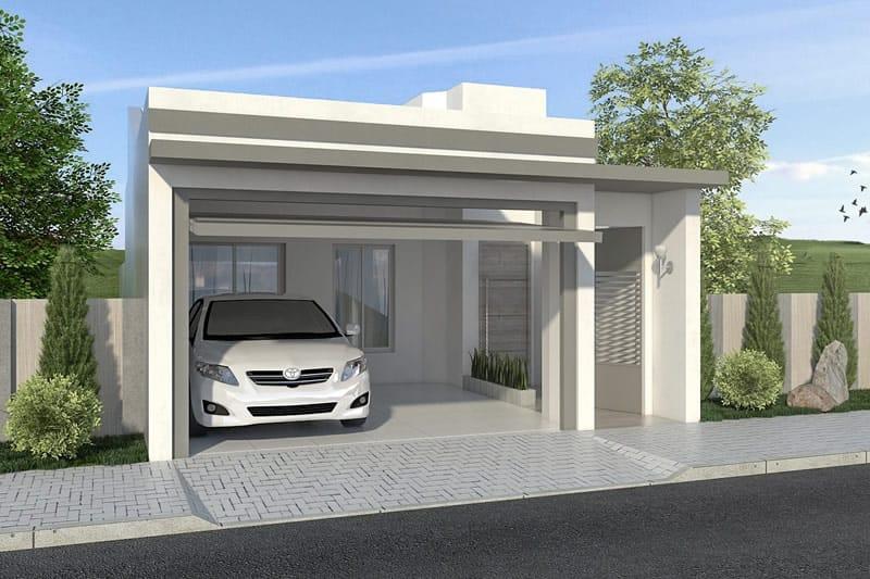 Fachada de casa simples com garagem coberta